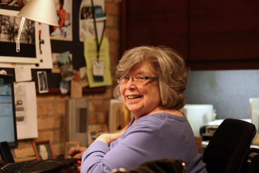 Cathie Cushing Duff at her desk in Cushing's River North office.