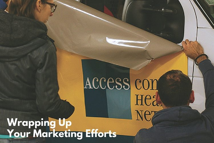 Wrapping up your marketing efforts 1 lauren works on a vehicle wrap for access medical