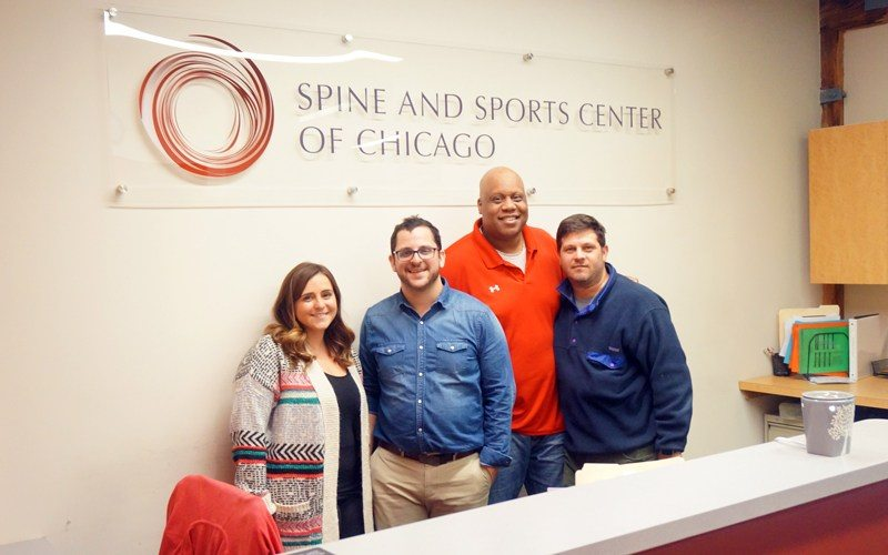 Sport and Spine Center Team With Acrylic Signage