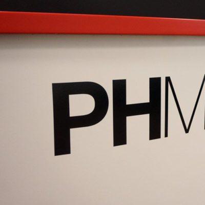 PHMG Front Desk Vinyl Cut Lettering