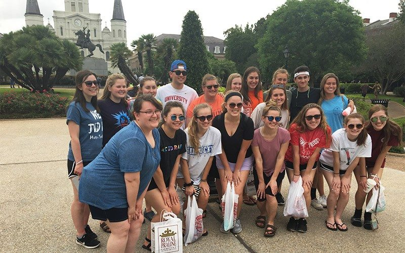 Giving Back In The Big Easy 5 Group Posing in Jackson Square