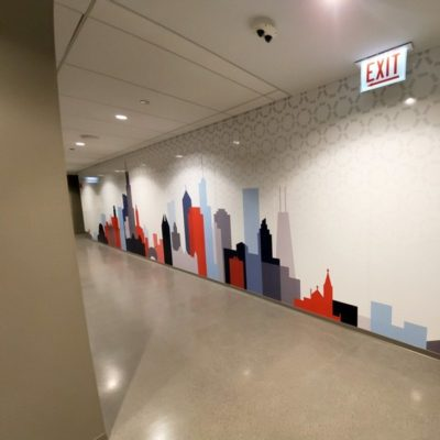 Wall Graphics With a Skyline in Office Hallway.
