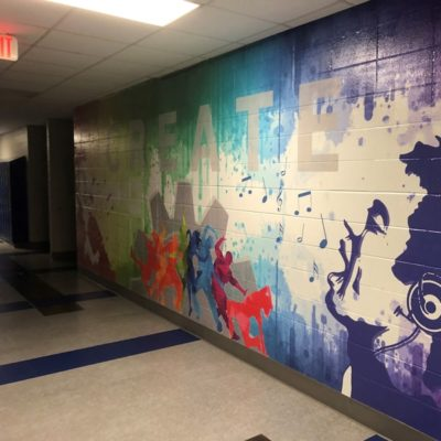 Colorful Wall Graphics in Middle School Hallway