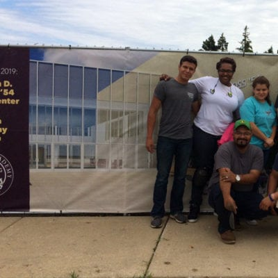 Cushing Team With Fence Wrap at Loyola Academy