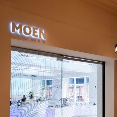 Front Entrance Privacy Film and Backlit Sign at Moen
