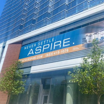 Exterior Leasing Banners Promote Rentals at Aspire.