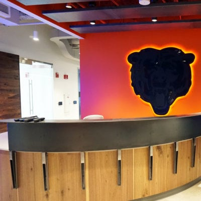 Backlit Acrylic Bears Graphic Behind Reception Desk