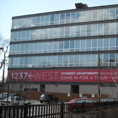 Exterior Banners Promote Student Housing