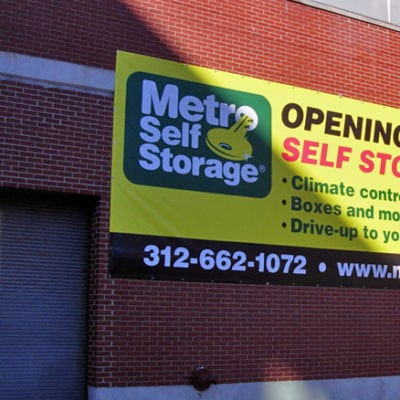 Metro Storage Banner on Building Exterior