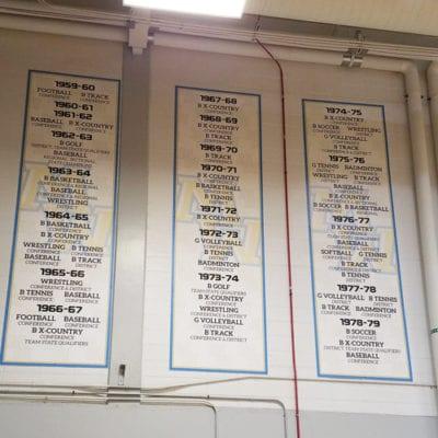 Vertical Maine West Banners in School Gymnasium