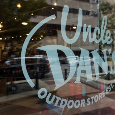 Close Up of Window Decal at Uncle Dan's Storefront