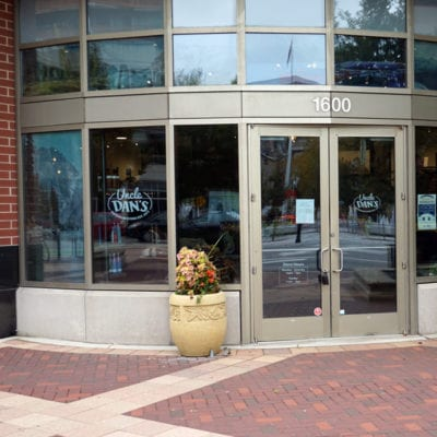Wide Display of Window Signage at Uncle Dan's Evanston Store