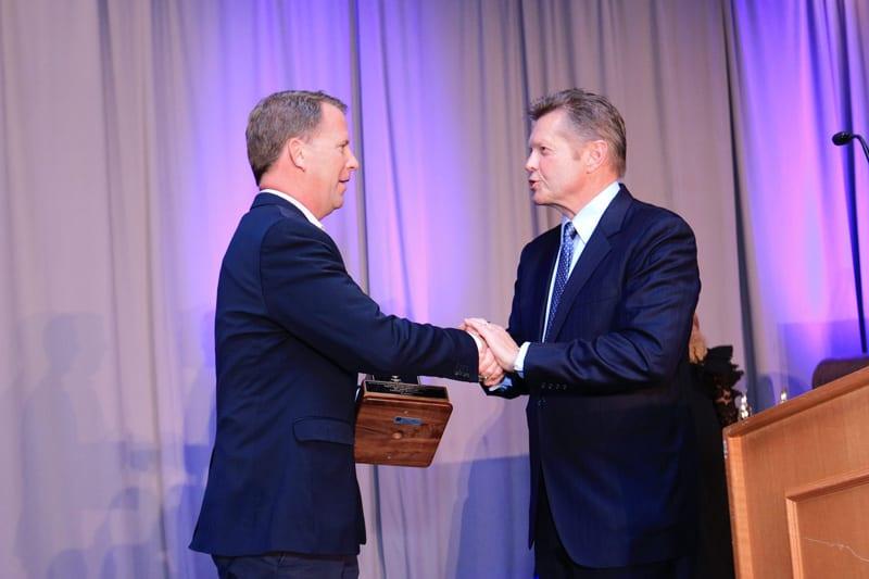 Cushing takes home a torch award 9 joe shaking hands