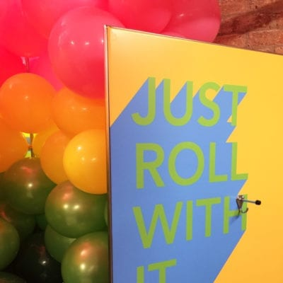 Close Up of Just Roll With It Interior Washroom Stall Graphics