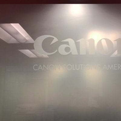 Canon logo Cut Out and Dusted First Surface