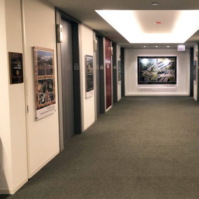 Wide Perspective of Elevator Bank Graphics and Acrylic