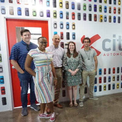Xcite Team with Wall Graphics