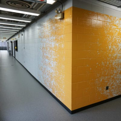 Colorful Wall Vinyl Installed to Concrete