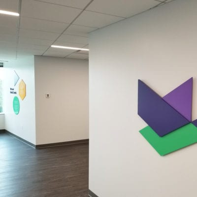 Dimensional Duck Creek Branding and Images Installed in Hallway
