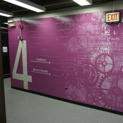 Vinyl Wall Graphic Installed to Concrete Wall at Cushing