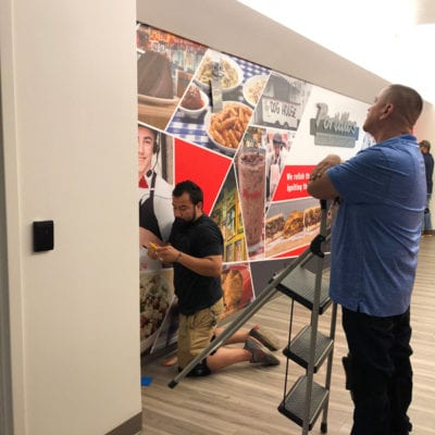 The Team Inspects the Wall Graphics Installation