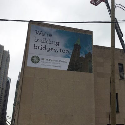 Building Banner Installed On Church Exterior