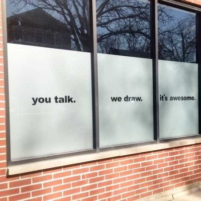 Side View of Window Signs at Ink Factory