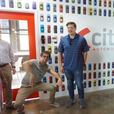 Candid Team Photo at Xcite With Wall Graphics