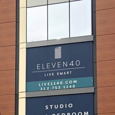 Close up of Window Graphics Promoting Available Apartments