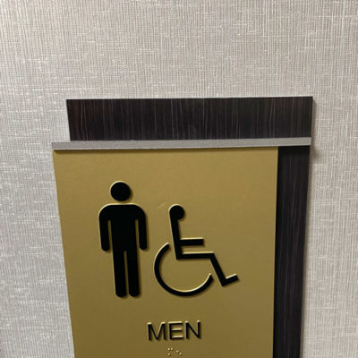 ADA Compliant Signage Installed to Denote Men's Washroom