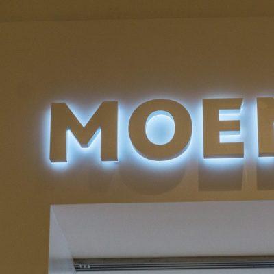 Close up of Moen Lit Signage