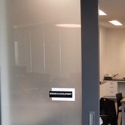Door Sign Installed to Conference Room Door