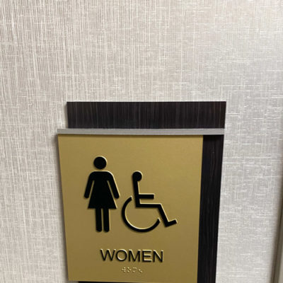 Restroom Sign Installed With Braille at Women's Washroom