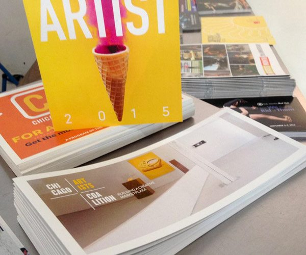 Marketing brochures and materials on display.