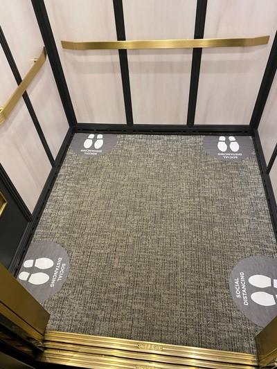 Social Distancing Floor Decals in Elevator