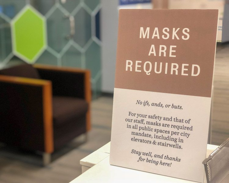 10 Measures Cushing Uses to Combat COVID-19 in the Workplace 1 Mask Signage Front Desk